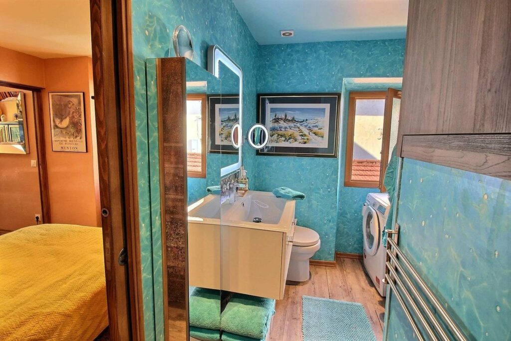 bathroom with blue tile walls at apartment in menton