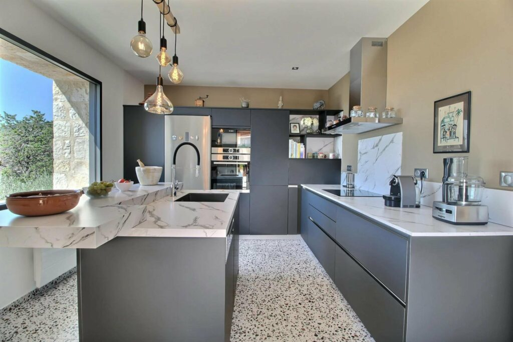 renovated kitchen with grey cabinets and chic design