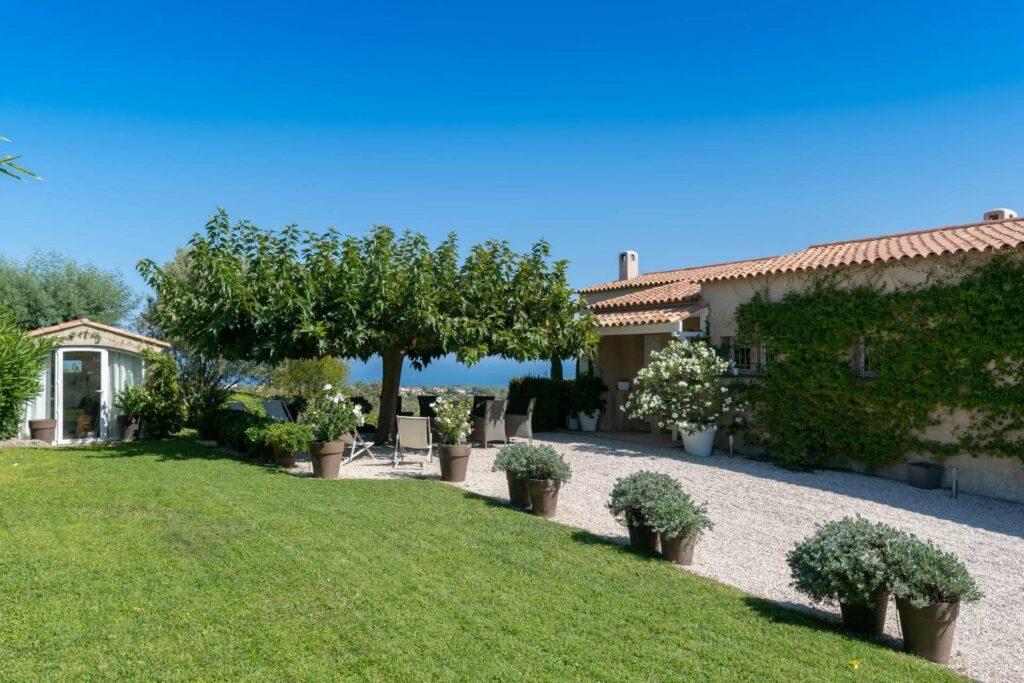 sone parking area of villa in biot with garden space