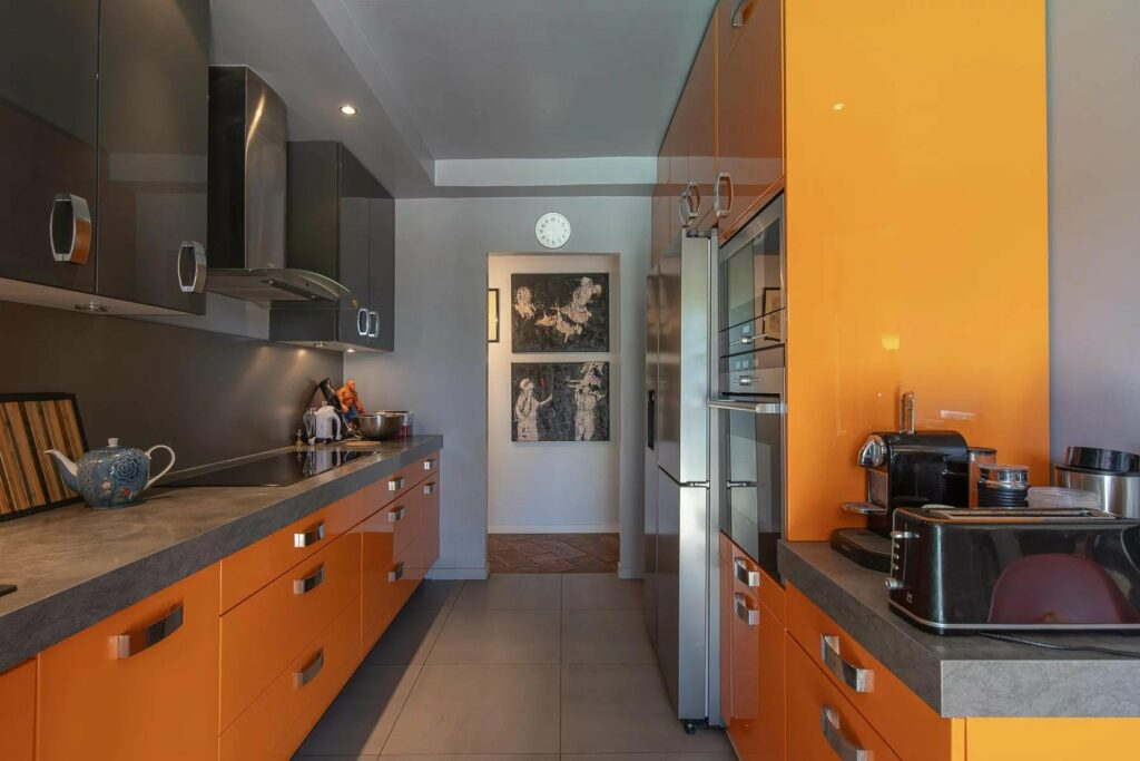 kitchen with orange and black theme coloring at south france villa