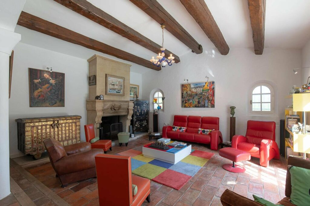 living room with colorful design and high ceilings