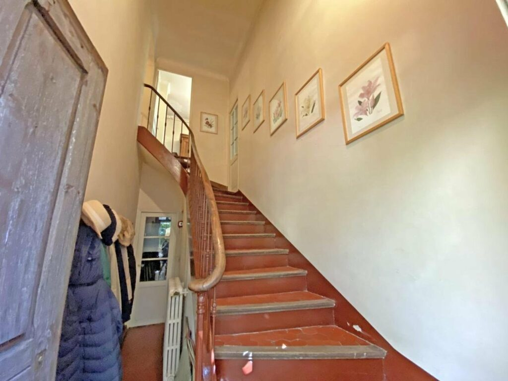 stairway of grasse house with beige walls