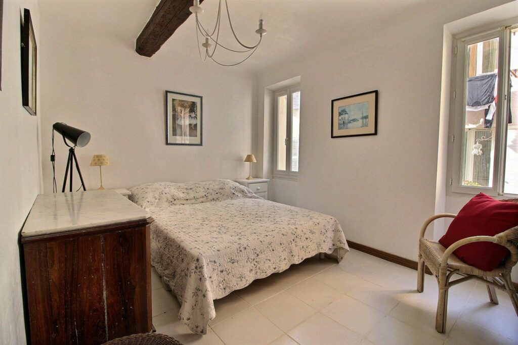 bedroom in antibes apartment with white bedding