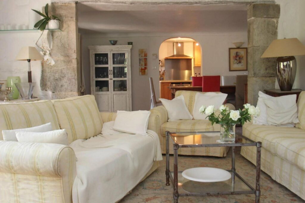 living room with view of kitchen in back of villa south france