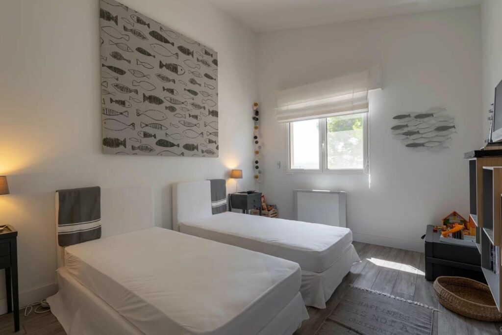bedroom with two single beds in biot house for sale
