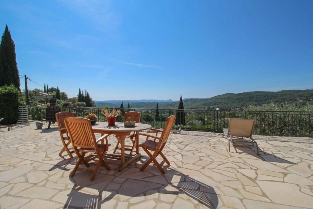 view from backyard of terrace of stone villa