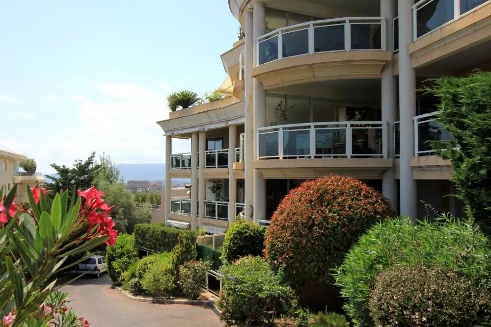 apartment complex with terrace and view of mountains