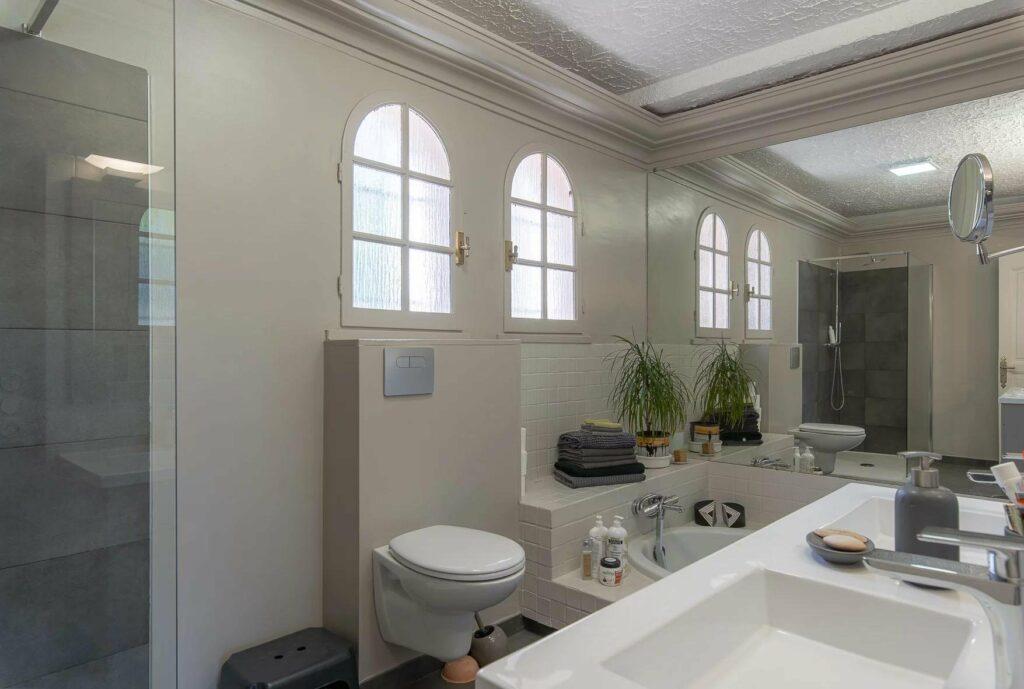 modern bathroom with all white design at villa