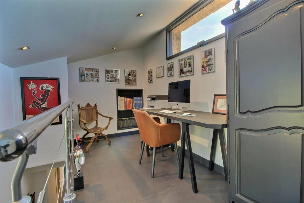 office with charming design and grey wood floors
