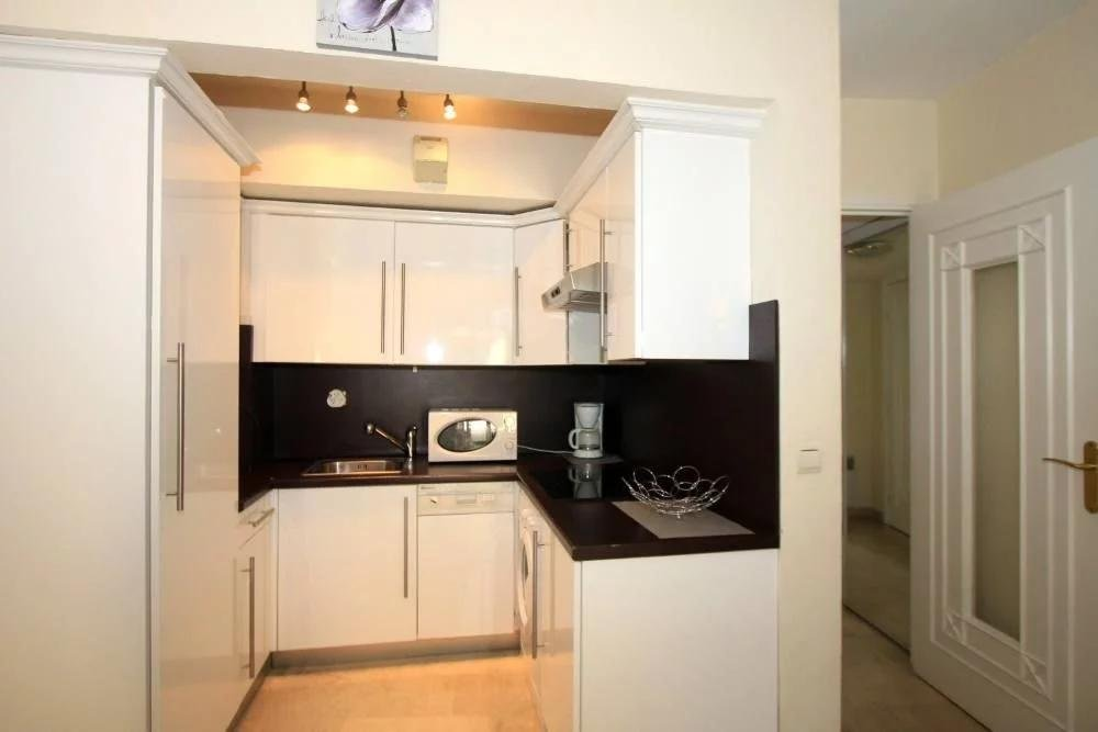kitchen with white cabinets and black counter tops