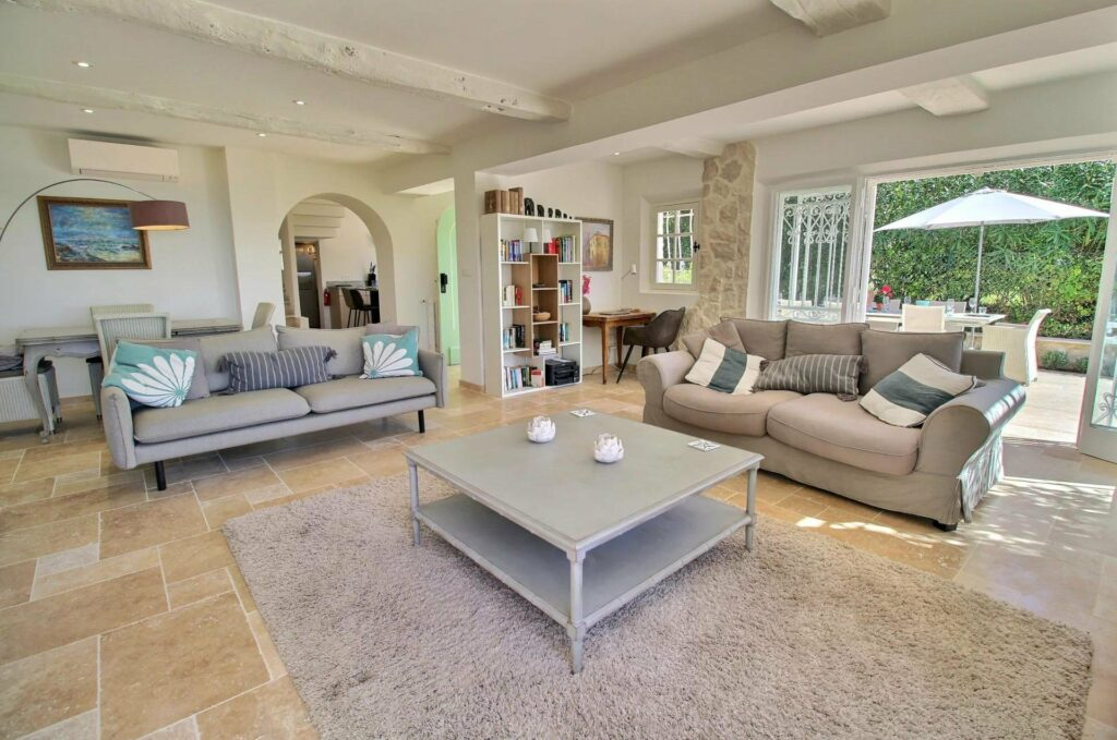 living room with center light grey wood table and chic design