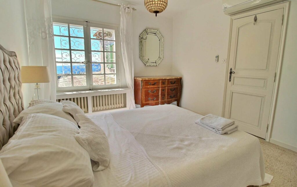 bright bedroom of provencal home in south france