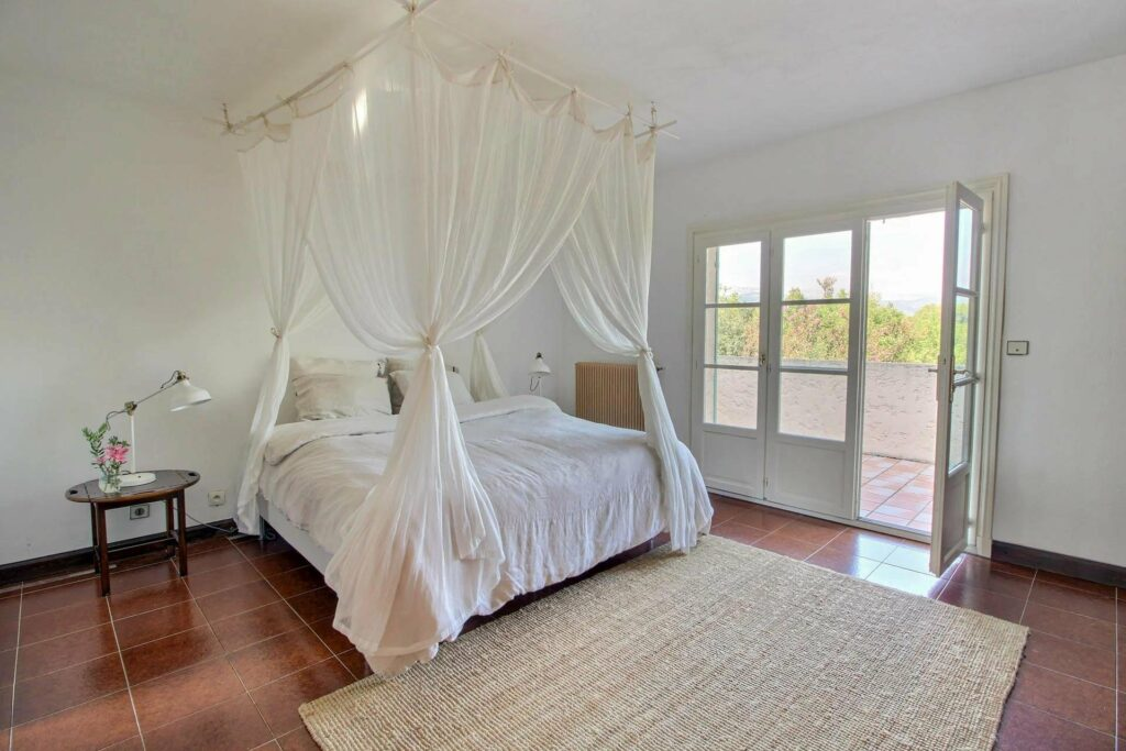 bedroom of provencal villa with swimming pool