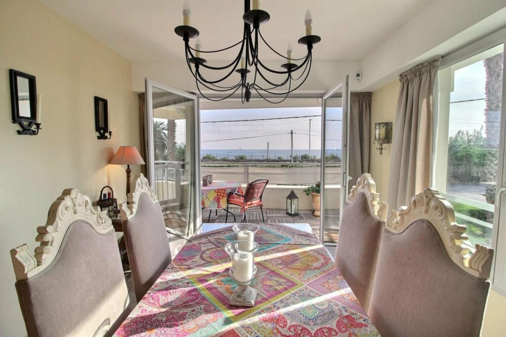 dining room with table facing sea view