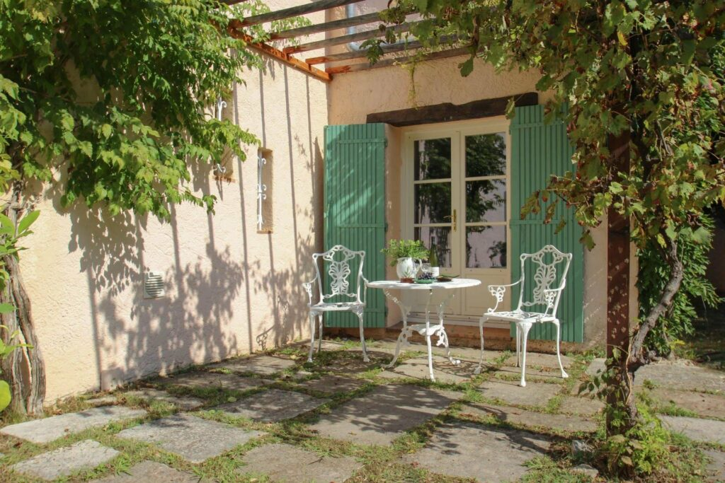 provencal villa with light green shutters and stone flooring
