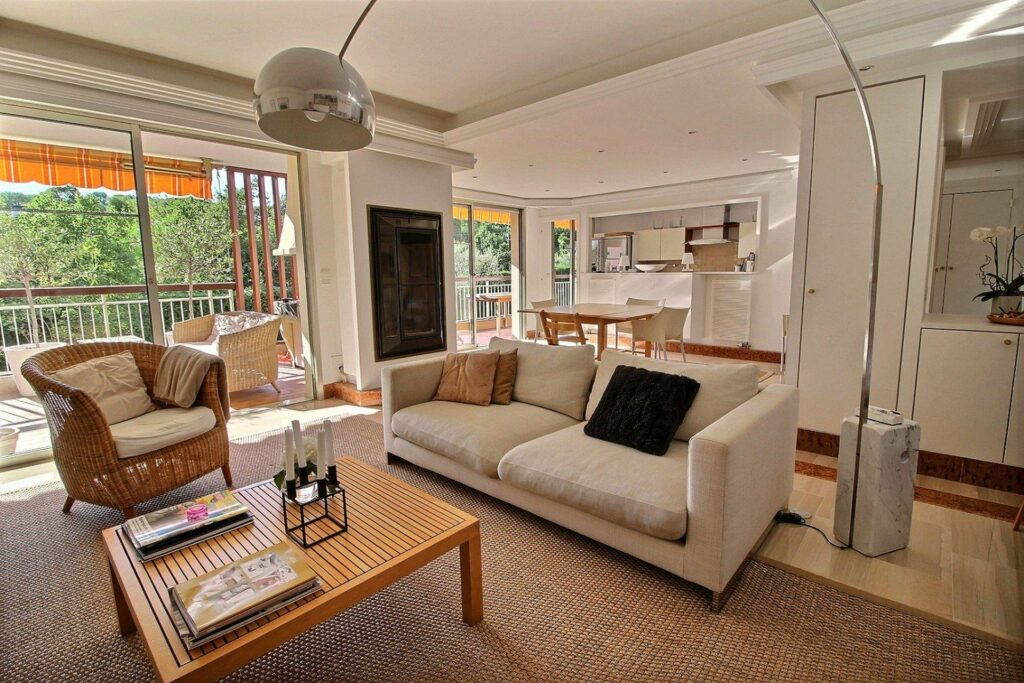 living room with beige couch and large textured rug