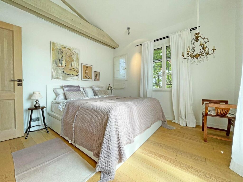 bedroom with chic design and light wood floors