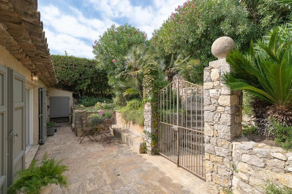 stone gate of villa for sale in france with mountain view