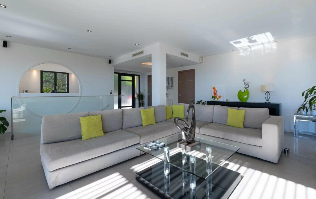 living room with grey couch and bright green pillows
