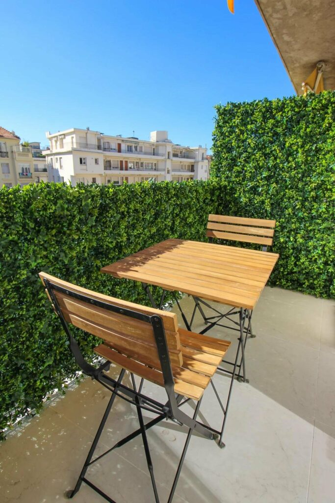terrace of apartment in south france with wood table