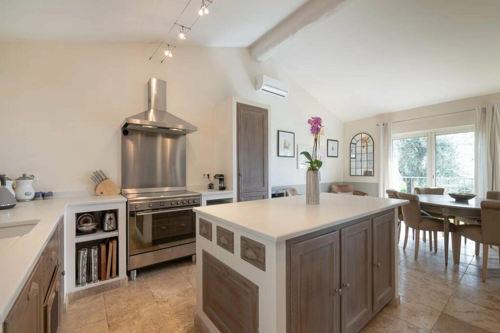 open modern kitchen with steel stove and island in center