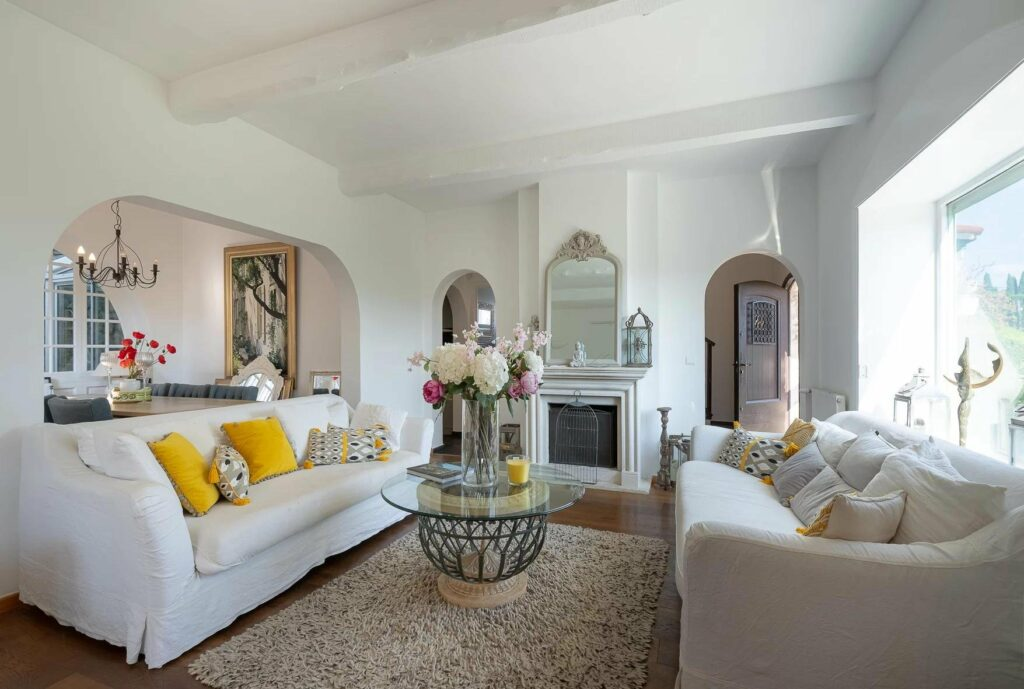 living room with white couch in property in south france