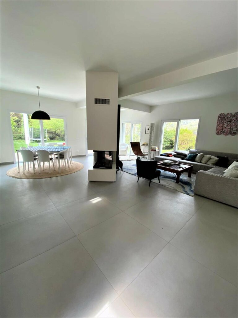open interior of villa in south france with grey tile floors and high ceilings
