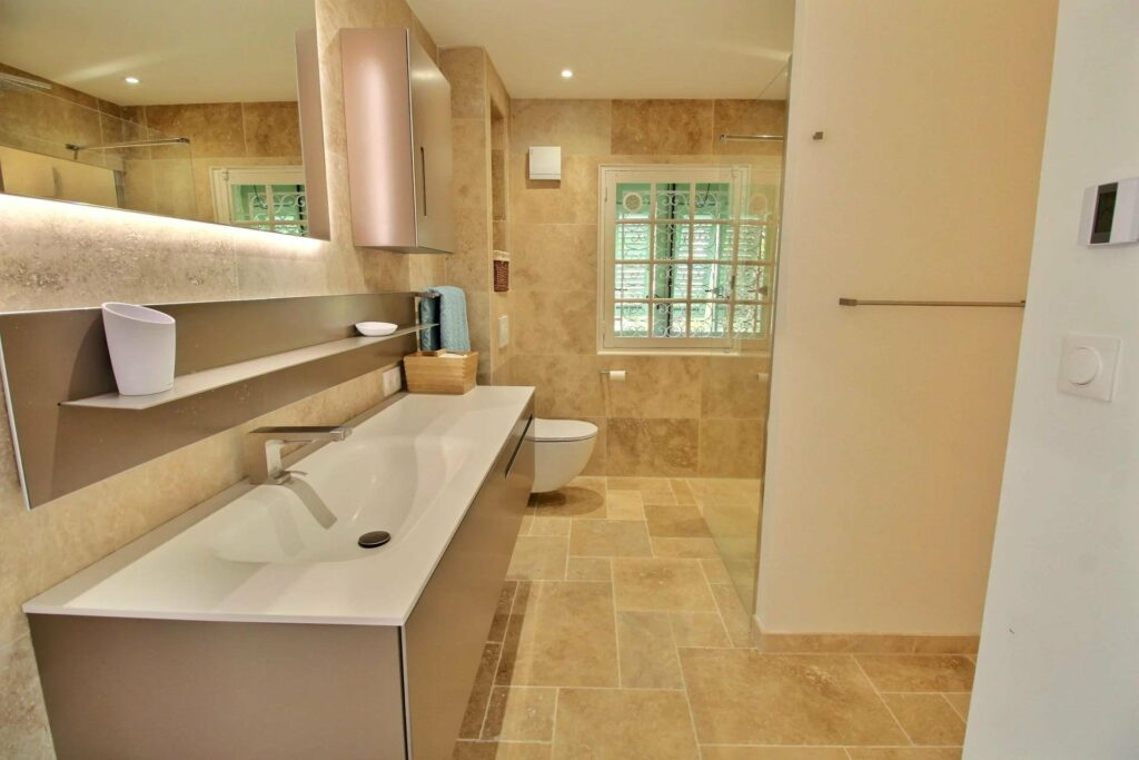 large open bathroom with beige colored tile