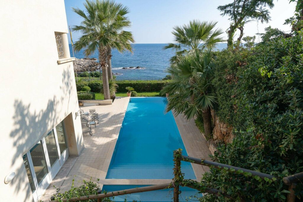 view of swimming pool facing sea in south france