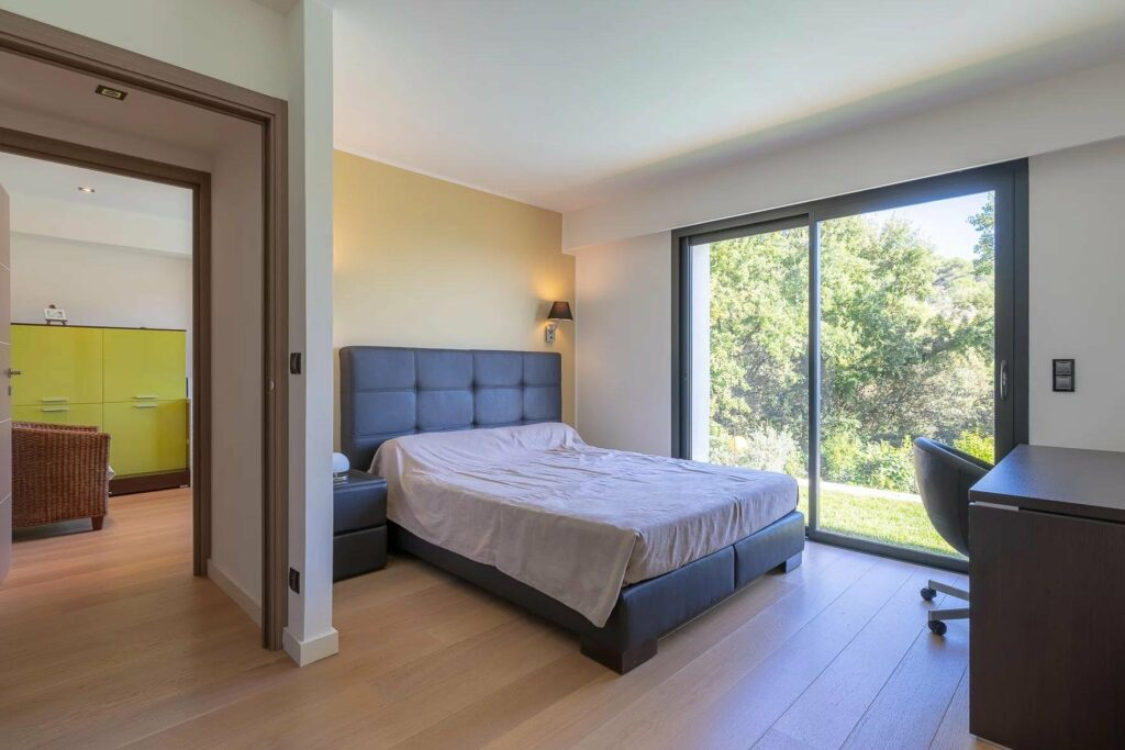 bedroom with wood floors and large terrace