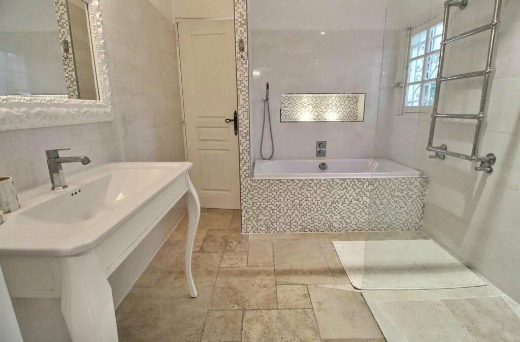 bright bathroom with white bathtub