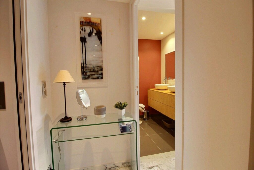 view of bathroom with orange walls of apartment in antibes