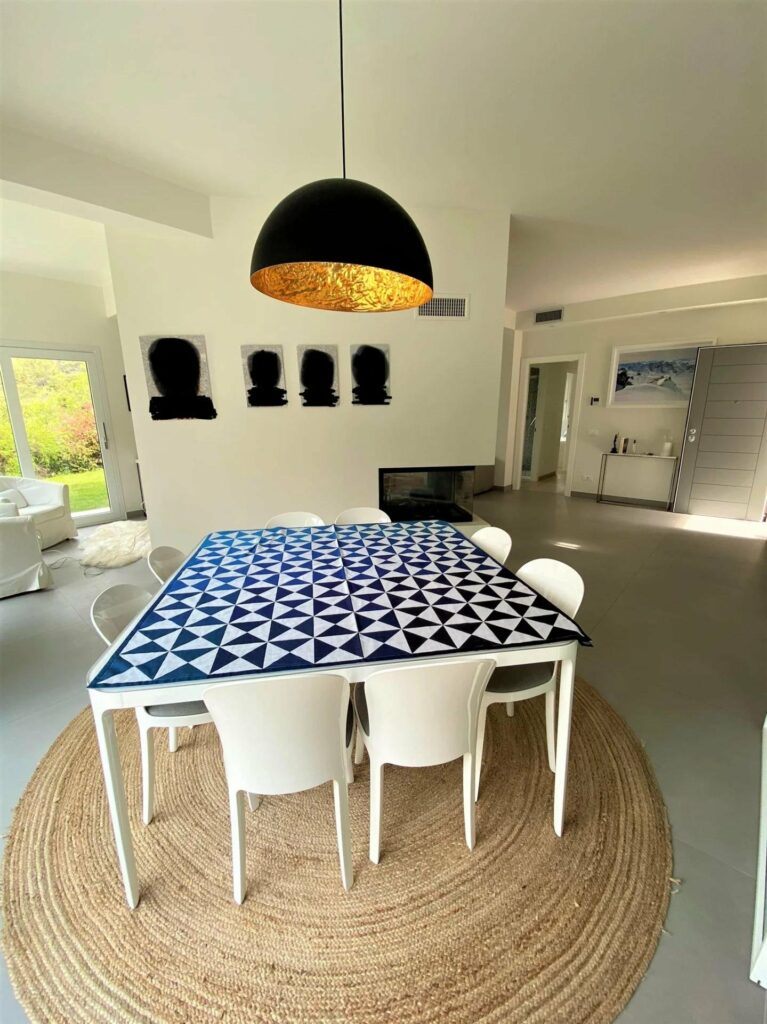 interior of modern villa with blue and white checkered table and white table