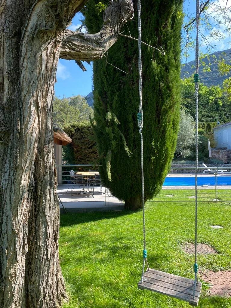 backyard with pool and swing hanging from tree