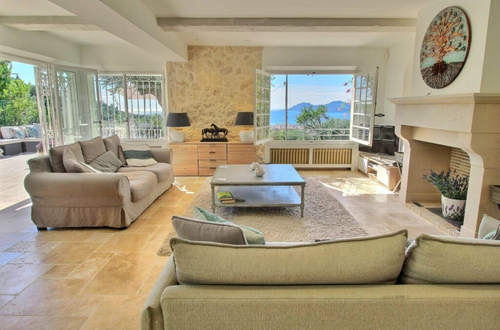 living room with wood floors and large windows with view of riviera
