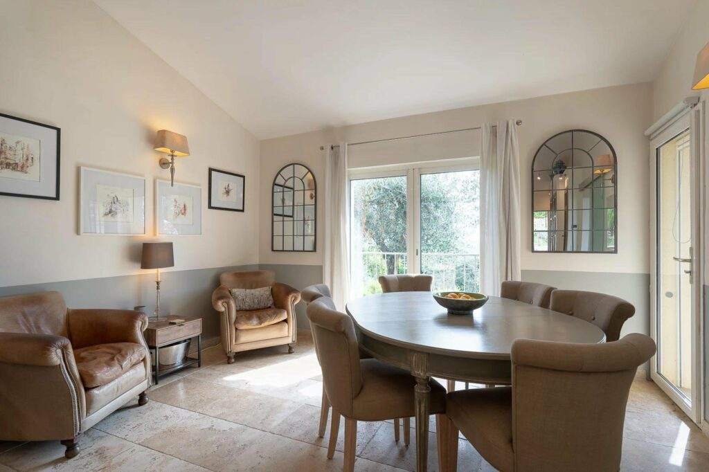 dining room with wood round table and sliding glass door to garden