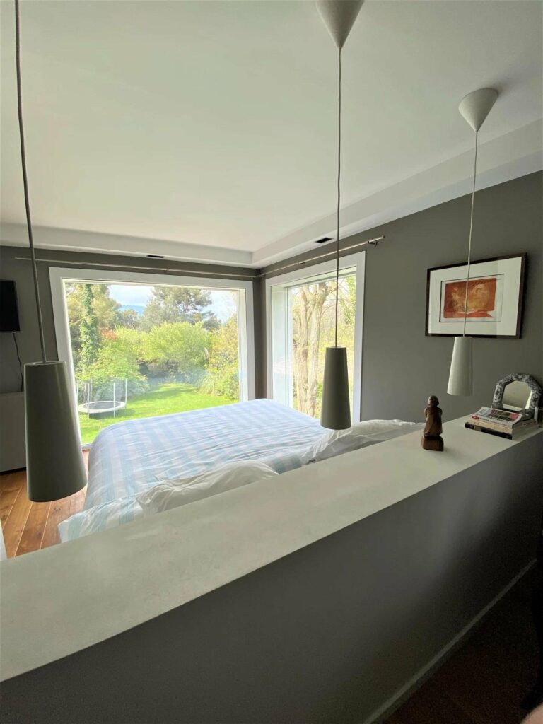 bedroom with large windows with view of the backyard
