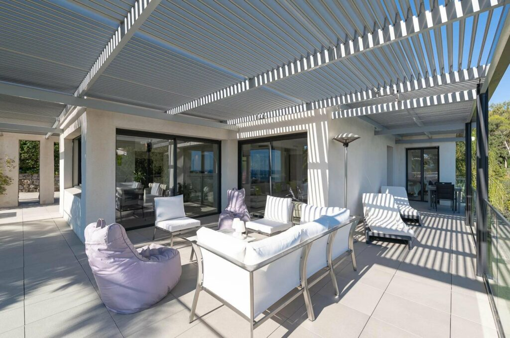 backyard with white outdoor furniture of villa in south france