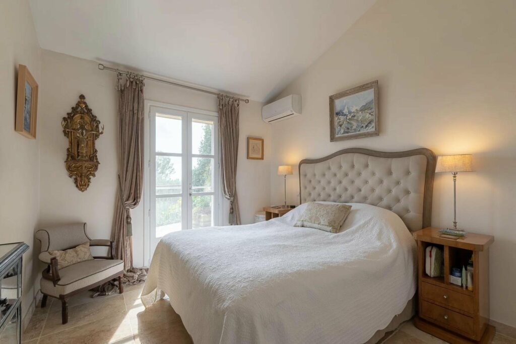 bedroom with white queen size bed and classic design